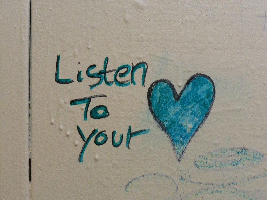 "graffiti on the wall, written ""listen to your heart"", giving advice to strangers"